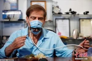 新发明口罩装上机械嘴吃饭时不必摘